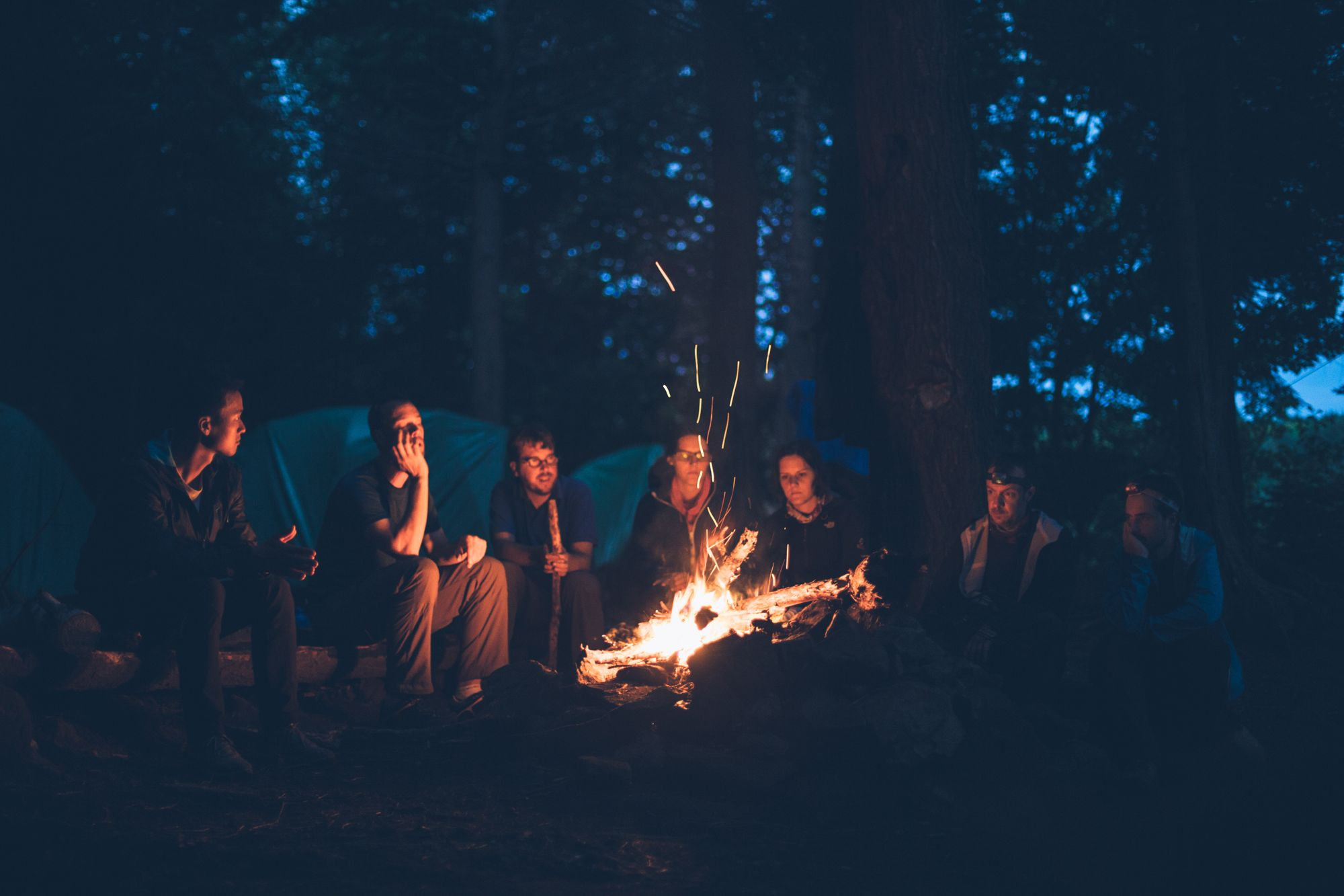 RV Campers sitting around a campfire